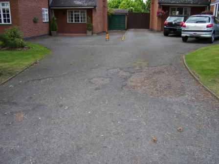 Tarmacadam driveway in need of resurfacing