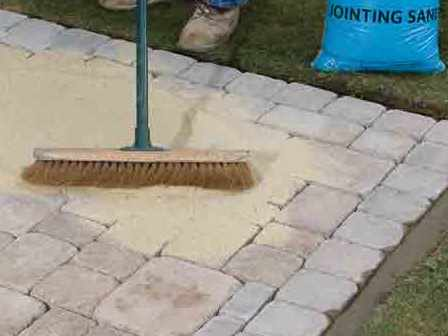 Brushing Jointing Sand into Block Paving