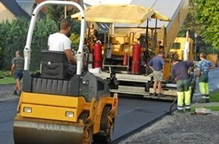 Tarmac Paving Prices - Compacting a Newly Installed Stone Mastic Asphalt Access Road