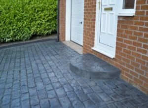 Stamped Concrete Prices - Lakeland Cobble Stamped Concrete Driveway with Half Moon Step