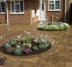 Planting areas in Royal AsGarden Paving Quote - Pattern Imprinted Concrete
