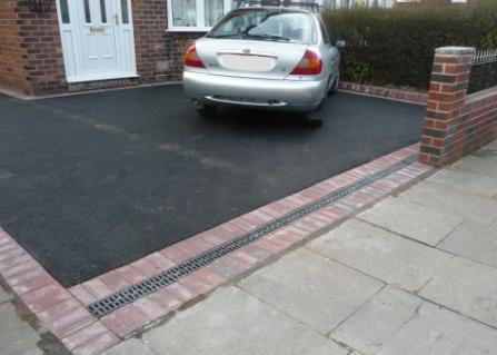 Tarmac Paving Prices - Black Tarmacadam Driveway with Aco Drainage at the Entrance