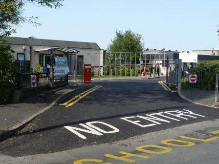 Newly laid SMA at a school, with thermoplastic paint signage