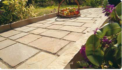 Sandstone copings, edges and setts providing a footpath to your patio area