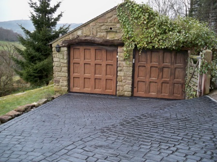 Pattern Imprinted Concrete Driveway up to a Double Garage