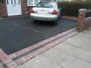 Black Tarmacadam Driveway with aco drainage at the entrance